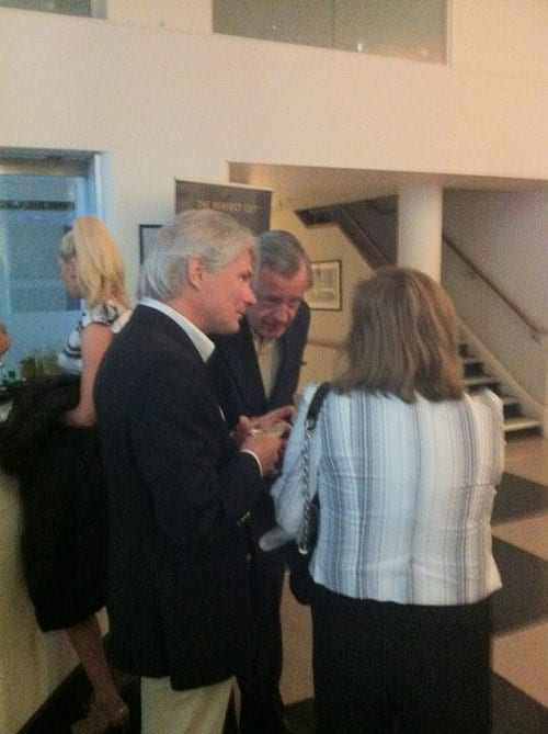 The Julian Assange lookalike in conversation at a party in the Berkeley Square Bentley showroom