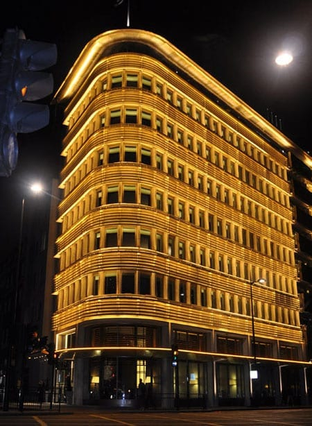 The magnificently lit exterior of 45 Park Lane at night