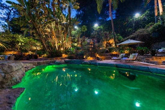 A lagoon pool is one of the features of the property's 1.5 acre plot