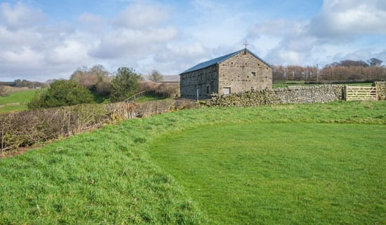 A large field barn offers potential for a variety of uses