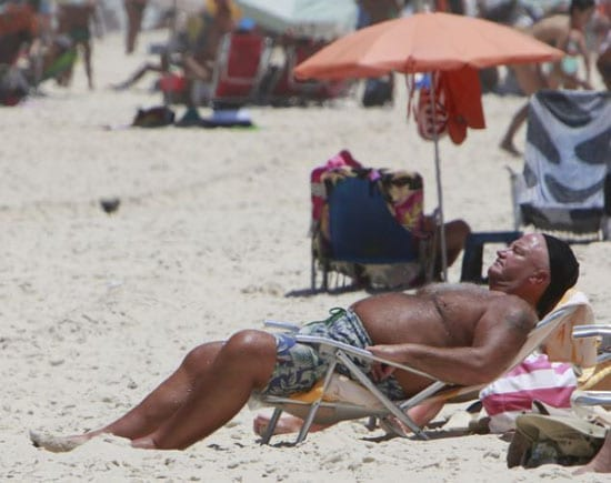 A lobster coloured Bob Crow is pictured on a beach in Brazil