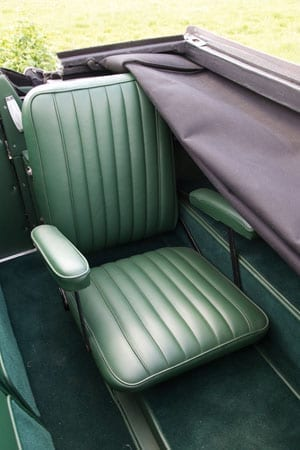 A passenger seat in the rear of the car