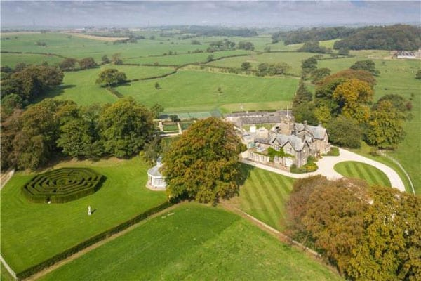 An aerial shot of the Hay Carr estate shows the house, summer house and maze