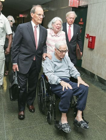Charlene Marshall wheels her husband Anthony Marshall into court on Friday 21st July 2013 accompanied by laywers Kenneth Warner (left) and David Zauderer (right)