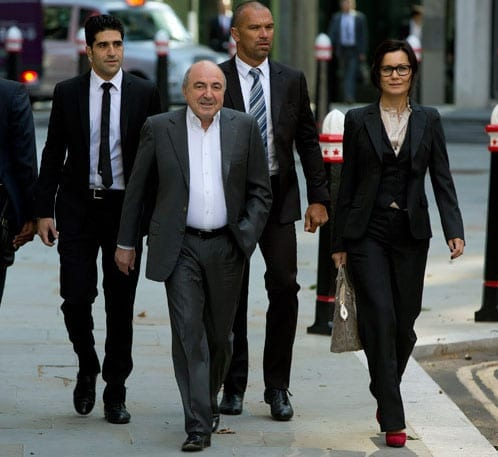 The late Boris Berezovsky arriving at court last year with his entourage of bodyguards