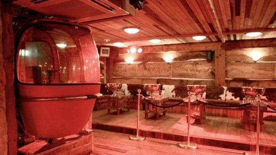 The DJ booth in the club area is housed in a vintage gondola