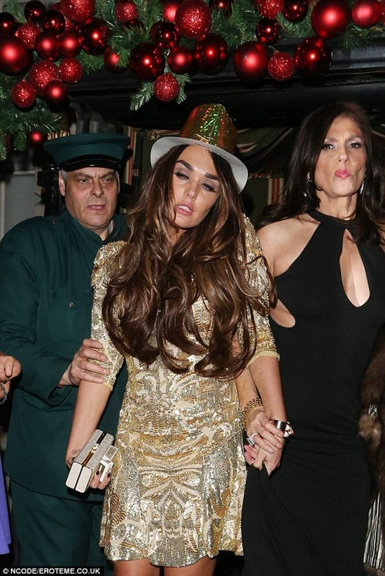 Famous for nothing other than her wealth... Tamara Ecclestone stumbles out of Annabel's on New Year's Eve 2012 propped up by her mother, Slavica