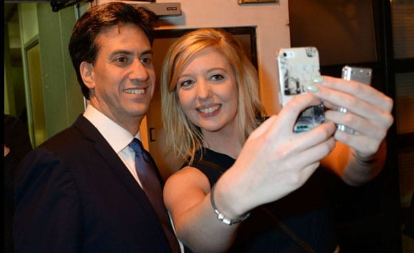 Ed Miliband attempts a selfie at the party with a guest