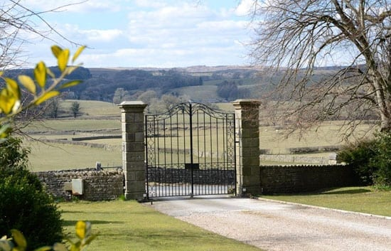 The gates of Burrow Hall with views to the River Lune beyond