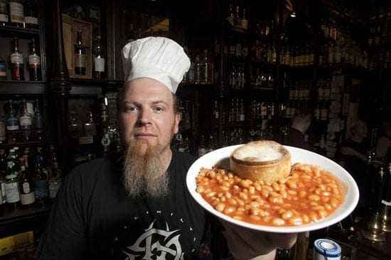 Owner of Glasgow's The Pot Still displays a typical dish on offer in his pub