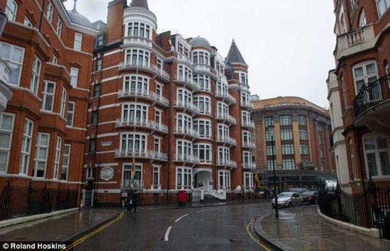 Julian Assange's sleeping patterns at the Ecuadorian Embassy (left) have allegedly been disturbed by deliveries to Harrods (right)