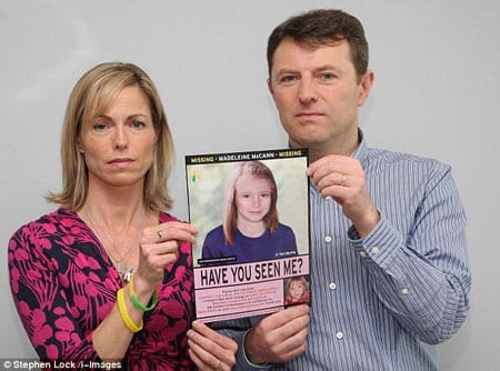 Kate and Gerry McCann with a poster depicting an artist's impression of how their daughter might now look