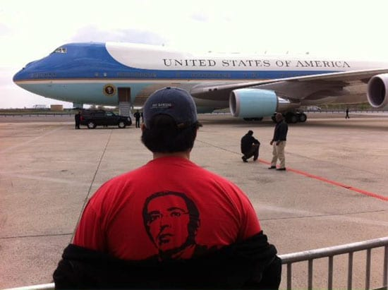 "Reader Lev Trubkovich wore a ""Free Khodorkovsky"" shirt under his jumper ""entirely by accident"" whilst covering President Obama arriving at JFK."