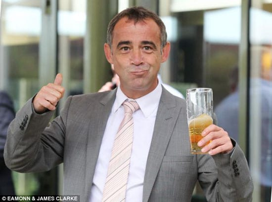 Michael Le Vell celebrates being cleared with a pint