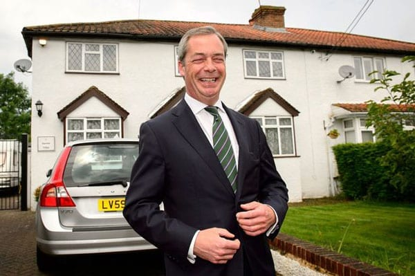 Nigel Farage outside his home
