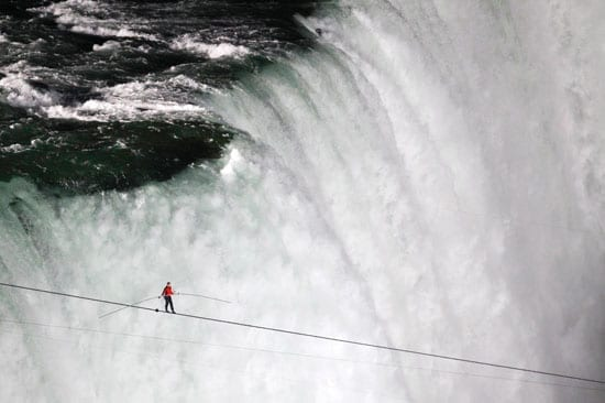 In June, a tightrope walker, Nik Wallenda, defied mist and wind to become the first man to walk across Niagara Falls on a high wire. His achievement was not only daring but also spectacular.