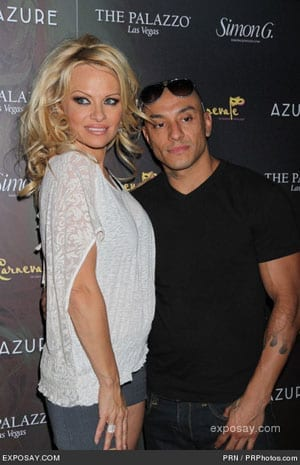 Former Baywatch star Pamela Anderson pictured with her current boyfriend, acrobat Jesus Villa