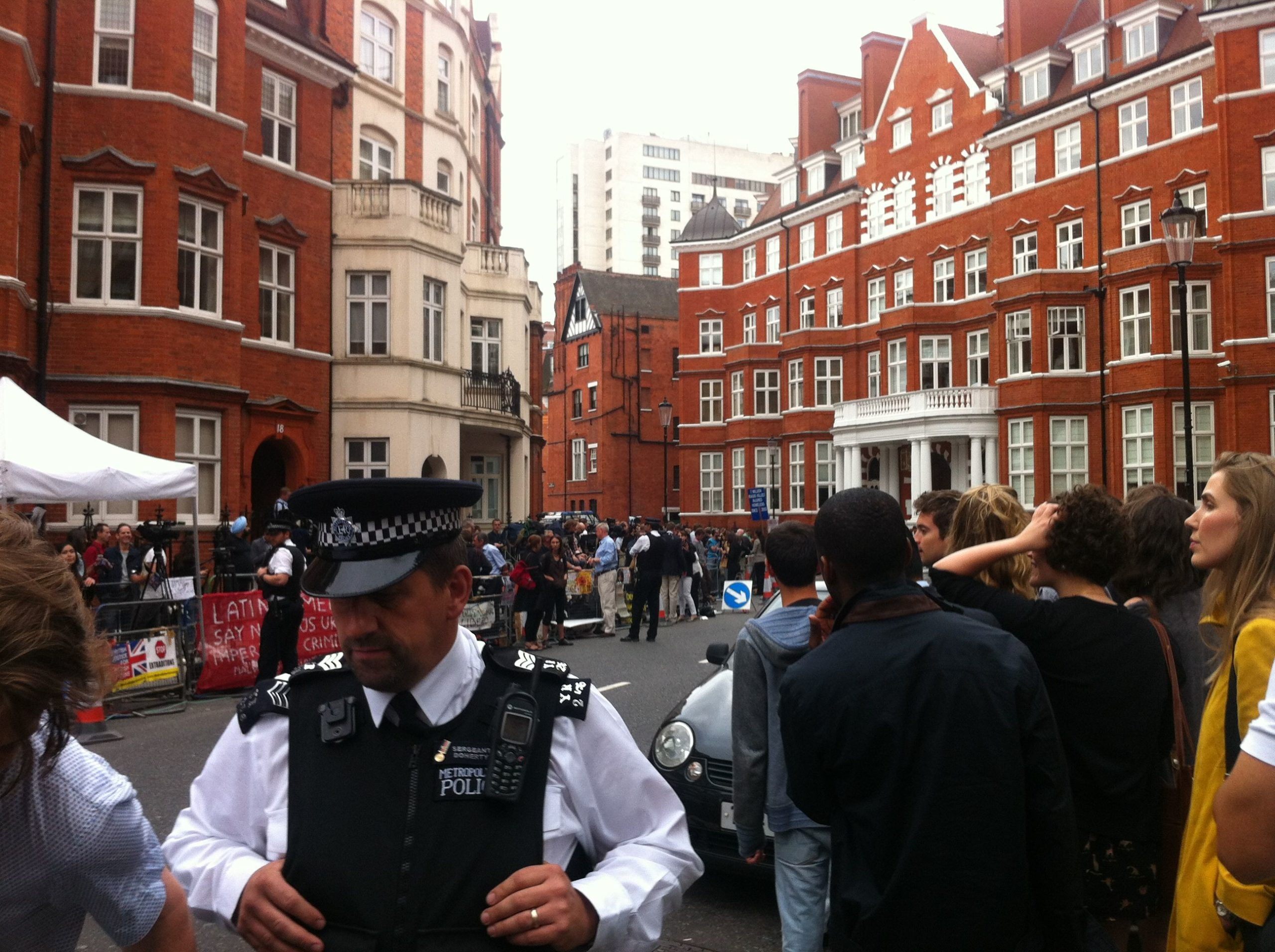Police and protestors scaled