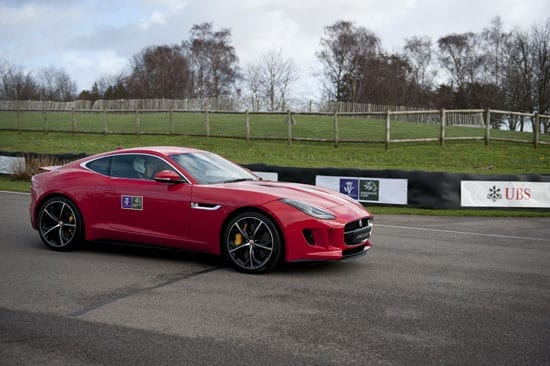 Prince Harry on Goodwood Motor Circuit's track in a Jaguar F-Type