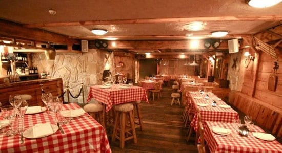 The restaurant and bar area is decorated in the style of a traditional alpine lodge