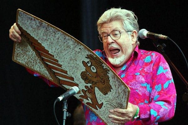 Team Harris cracks - Rolf Harris supporters go to war with one another