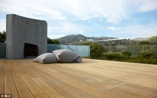 The house includes a large roof deck with mountain views