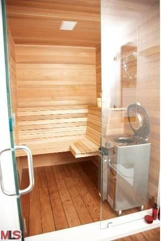 A glass shower comes complete with a built in Finnish sauna and television
