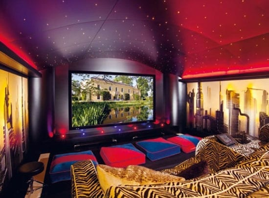 The cinema room features a 10 foot acoustically transparent Stewart screen, 7 channel surround sound and bespoke seating with inbuilt Crestron controls