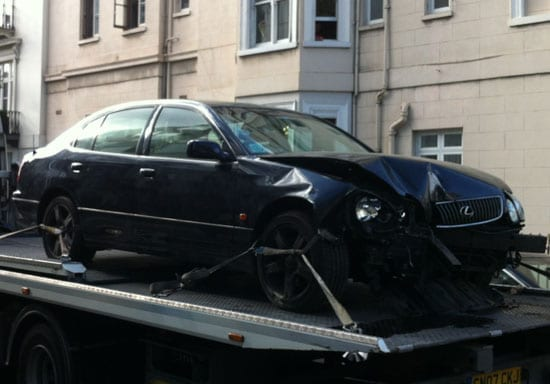 The damaged Lexus is taken away and is presumably a write off