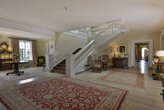 The house includes a large staircase hall