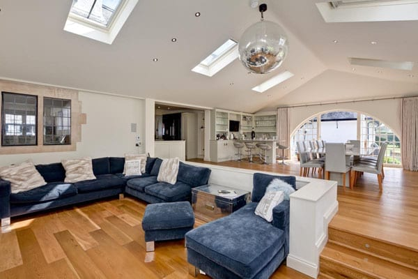 The house is contemporarily decorated and includes open plan reception areas