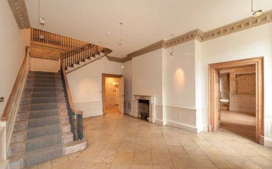 The main staircase hall is again indicative of a house that needs an input of personality