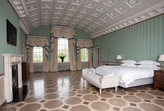 The master bedroom suite also includes a plaster ceiling