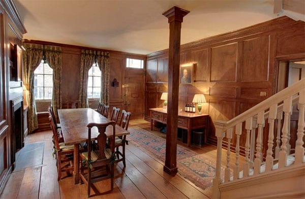 The paneled entrance hall doubles as a dining room
