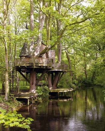 The professionally constructed treehouse on a moated island will please adults and children alike
