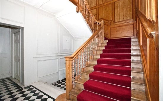 The property includes an imposing staircase