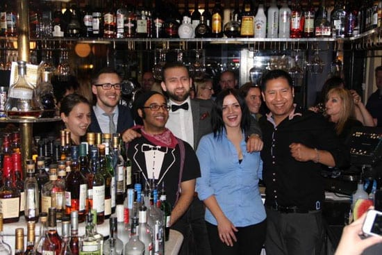 The six entrants gather behind the bar