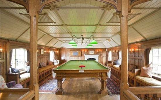 The snooker room is linen-fold oak panelled snooker room and features French oak floors, a bar area and air-conditioning