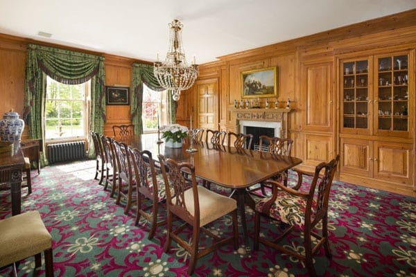 The wood panelled dining room can comfortably seat eighteen