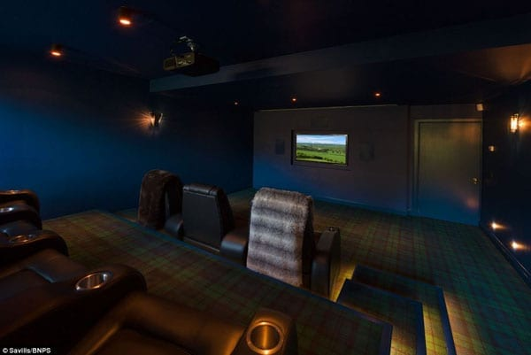 There is also a cinema complete with tartan carpeting