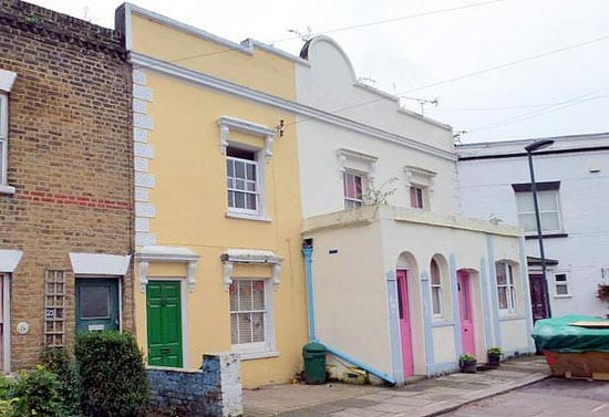 This colourful cottage comes complete with the remains of two former owners