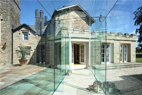 This glass link cleverly links the main building to the new library and palm house