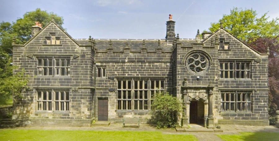 A Wheel Window – Wood Lane Hall, Wood Lane, Sowerby Bridge, West Yorkshire, HX6 1NE, United Kingdom – For sale for £750,000 ($980,000, €842,000 or درهم3.6 million) through Edkins & Holmes - Grade I listed Tudor open hall house for sale; it comes complete with a replica cabin from a 1920s ocean liner and an 'apple and pear wheel window'