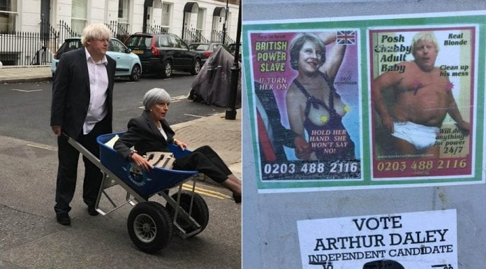 Theresa Calls By – Theresa May spotted in wheel barrow – Boris Johnson pictured wheeling Theresa May around Chelsea in a wheel barrow whilst elsewhere the pair of them make themselves known in a phone box