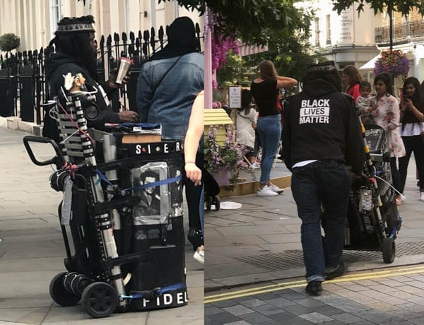 'Mr Black Lives Matter' – Little is known about this Belgravia entertainer – A regular outside Peggy Porschen's Parlour, 116 Ebury Street, Belgravia, London, SW1W 9QQ 'Mr Black Lives Matter' attempts to entertain those queuing for cakes.