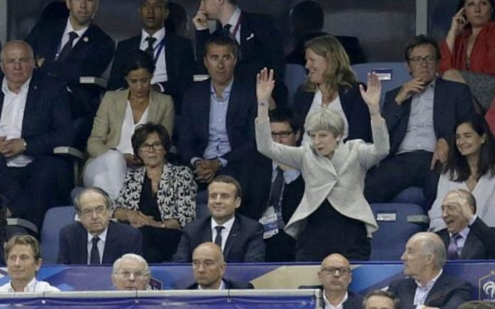 Waving in the Wheat – Theresa May makes a berk of herself (again) – As Theresa May makes a berk of herself at a football game, gin hater William Hanson and Tory fop Jacob Rees-Mogg MP share their views on wheatfield running