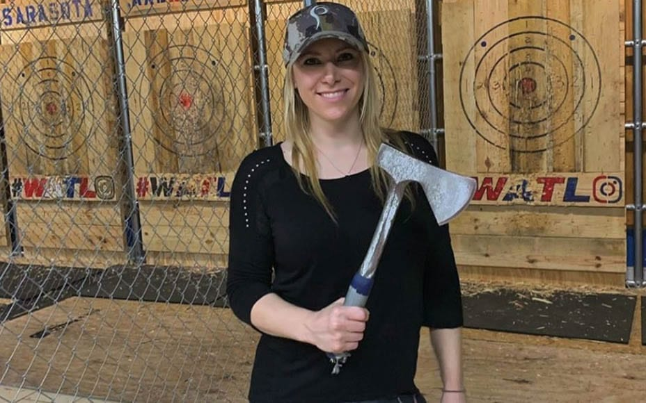 Axing Switlyk – Sex toy loving Larysa Switlyk appears in a video hurling axes at a wall whilst trying to flog ghastly leggings.