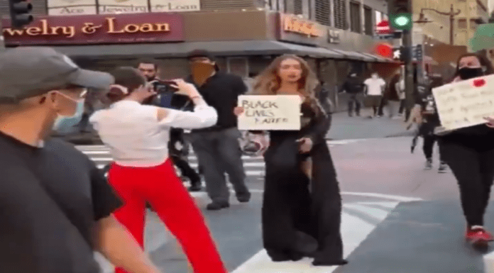 """Clickbait Crazy – 'Protest Barbie' Kris Schatzel named and shamed – White woman Kris Schatzel caught posing with a 'Black Lives Matters' sign in a """"slutty"""" outfit is exposed as a clickbait crazy 'Protest Barbie'"""